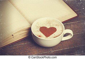Cup of coffee with notebook