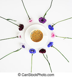 Cup of coffee with pattern from petals of wildflower.