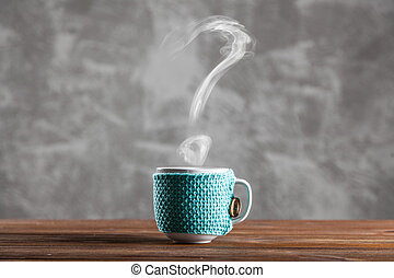 Cup of coffee with question mark shaped steam