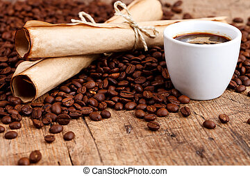 Cup of coffee with rustic paper rolls