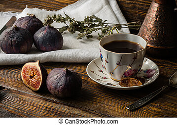 Cup of coffee with some figs for breakfast