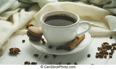Cup of coffee with spices and macaron - White elegant cup on...