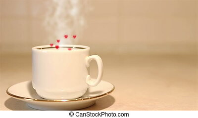Cup of coffee with steam and hearts