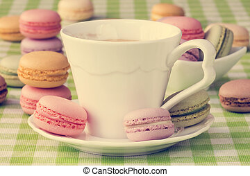 Cup of coffee with sweet macaroon biscuits