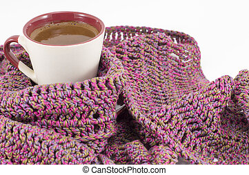 Cup of coffee wrapped in winter scarf