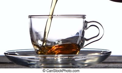 Cup of delicious fragrant black tea for breakfast. White...