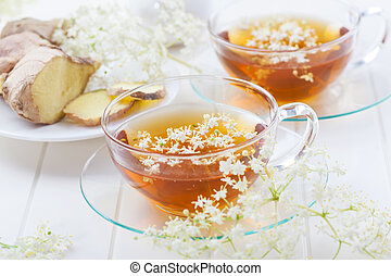 Cup of elder flower tea with ginger