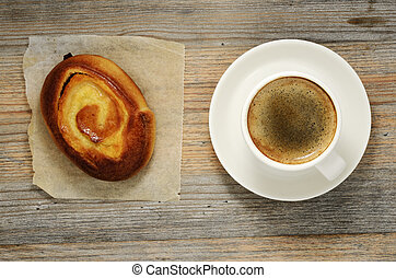 cup of espresso and fresh bun