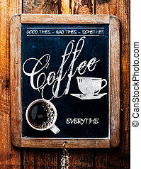 Cup of espresso coffee on a catchy sign
