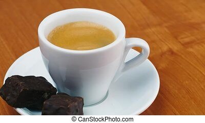 cup of espresso with candy