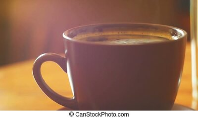 Cup of espresso with steam over. Macro video with shallow...
