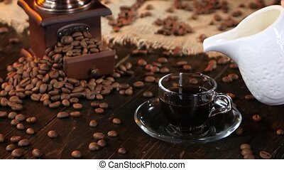 Cup of fresh coffee with milk or cream for breakfast