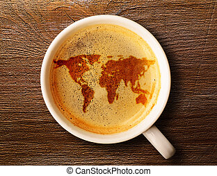 cup of fresh espresso on table - world map on cup of fresh...