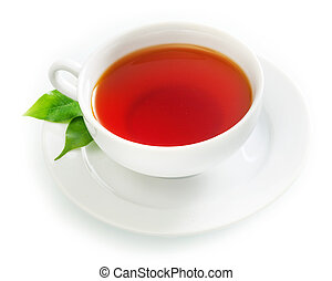 Cup of fresh hot black tea in an elegant plain white cup and saucer with fresh green tea leaves over a white background