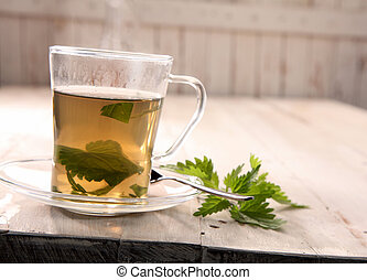 Cup of fresh stinging nettle tea - Cup of healthy fresh...
