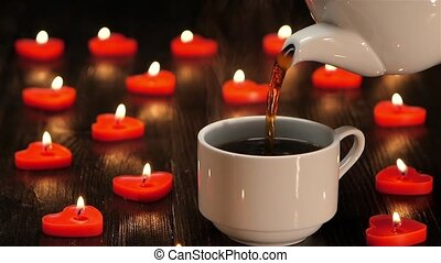Cup of freshly brewed and fragrant coffee by romantic candlelight