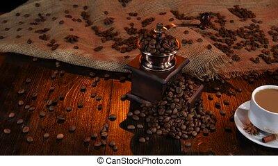 Cup of freshly brewed latte and milk jug. Coffee beans - Cup...