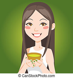 Cup of Green Tea - Portrait of a pretty Asian woman drinking...