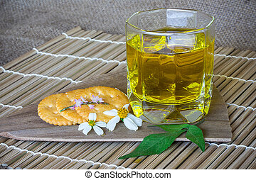 cup of green tea with flowers