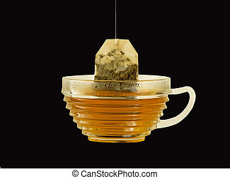 Cup of herbal tea on a black background