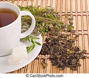 cup of herbal tea, teapot and sugar - the cup of herbal tea...