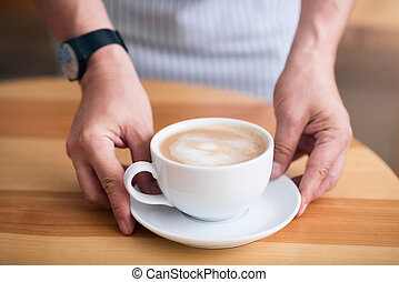 Cup of hot and nourishing coffee