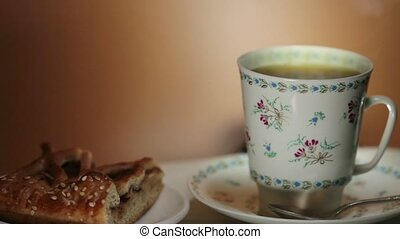 Cup of hot aromatic coffee close to