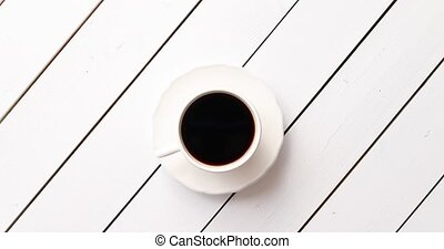 Cup of hot beverage on table - From above shot of cup of...