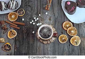 cup of hot black coffee on a gray wooden surface