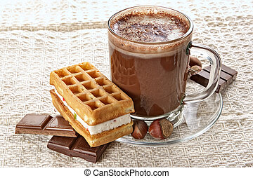 Cup of hot chocolate and wafer-nourishing high-calorie breakfast