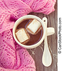 cup of hot chocolate wrapped in a scarf