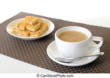 cup of hot coffee and biscuit