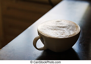 cup of hot coffee on a dark background