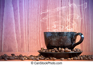 Cup of hot coffee on a wooden background