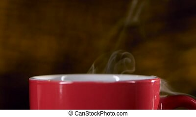 Cup of hot coffee with a delicious spreads pleasant aroma. Close-up