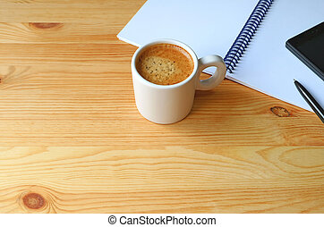 Cup of Hot Coffee with a Notebook and Cellphone on Wooden Working Desk, Free Space for Design