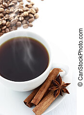 Cup of Hot Coffee with Cinnamon Sticks, Star Anise and Coffee Beans