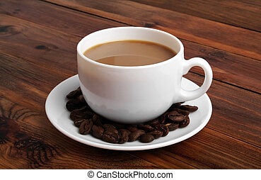 Cup of hot coffee with coffee beans on rustic wooden background