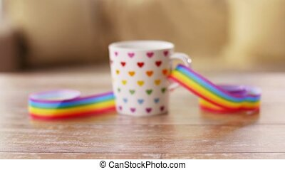 cup of hot drink with gay pride awareness ribbon -...