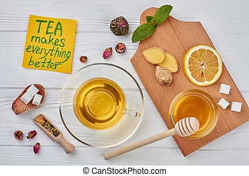 Cup of hot tea and healthy natural ingredients.