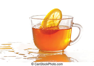 Cup of ice tea and lemon with splash on a white background