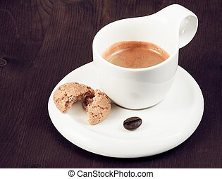 cup of italian espresso coffee and biscuit near coffee bean