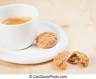 cup of italian espresso coffee near biscuit