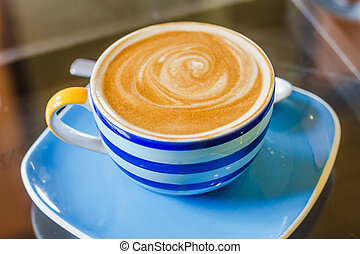Cup of latte coffee - Blue and white cup of latte coffee