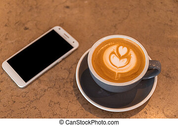 Cup of Latte coffee with smart phone