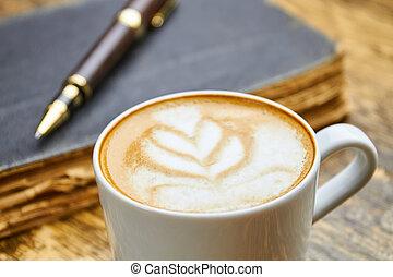 Cup of latte macro.