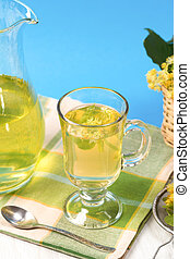 Cup of linden tea near ot carafe