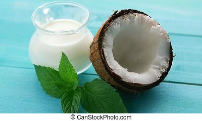 Cup of milk and half of coconut - Closeup shot of composed...