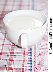 Cup of milk on the table