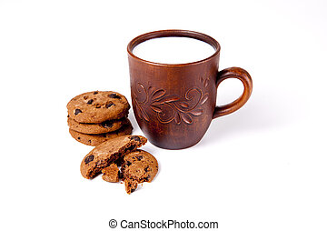 Cup of milk with biscuits on white background.